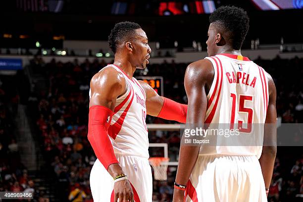 Dwight Howard and Clint Capela of the Houston Rockets have a quick discussion during the game against the Philadelphia 76ers on November 27 2015 at...