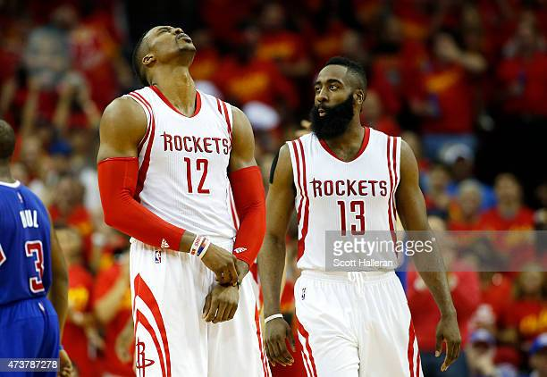 Dwight Howard and James Harden of the Houston Rockets react in the fourth quarter against the Los Angeles Clippers during Game Seven of the Western...