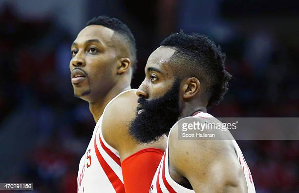 Dwight Howard and James Harden of the Houston Rockets wait on the court against the Dallas Mavericks during Game One in the Western Conference...