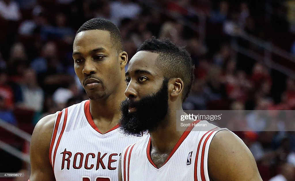 <a gi-track='captionPersonalityLinkClicked' href=/galleries/search?phrase=Dwight+Howard&family=editorial&specificpeople=201570 ng-click='$event.stopPropagation()'>Dwight Howard</a> #12 and <a gi-track='captionPersonalityLinkClicked' href=/galleries/search?phrase=James+Harden&family=editorial&specificpeople=4215938 ng-click='$event.stopPropagation()'>James Harden</a> #13 of the Houston Rockets walk across the court during the game against the Detroit Pistons at the Toyota Center on March 1, 2014 in Houston, Texas.