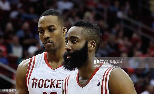 Dwight Howard and James Harden of the Houston Rockets walk across the court during the game against the Detroit Pistons at the Toyota Center on March...
