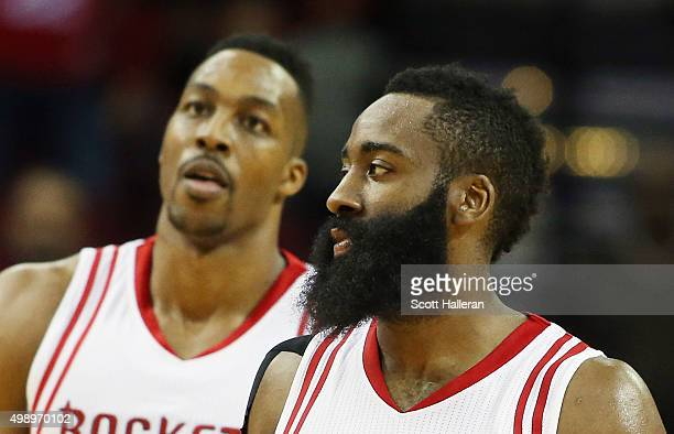 Dwight Howard and James Harden of the Houston Rockets walk up the court during their game against the Philadelphia 76ers at the Toyota Center on...