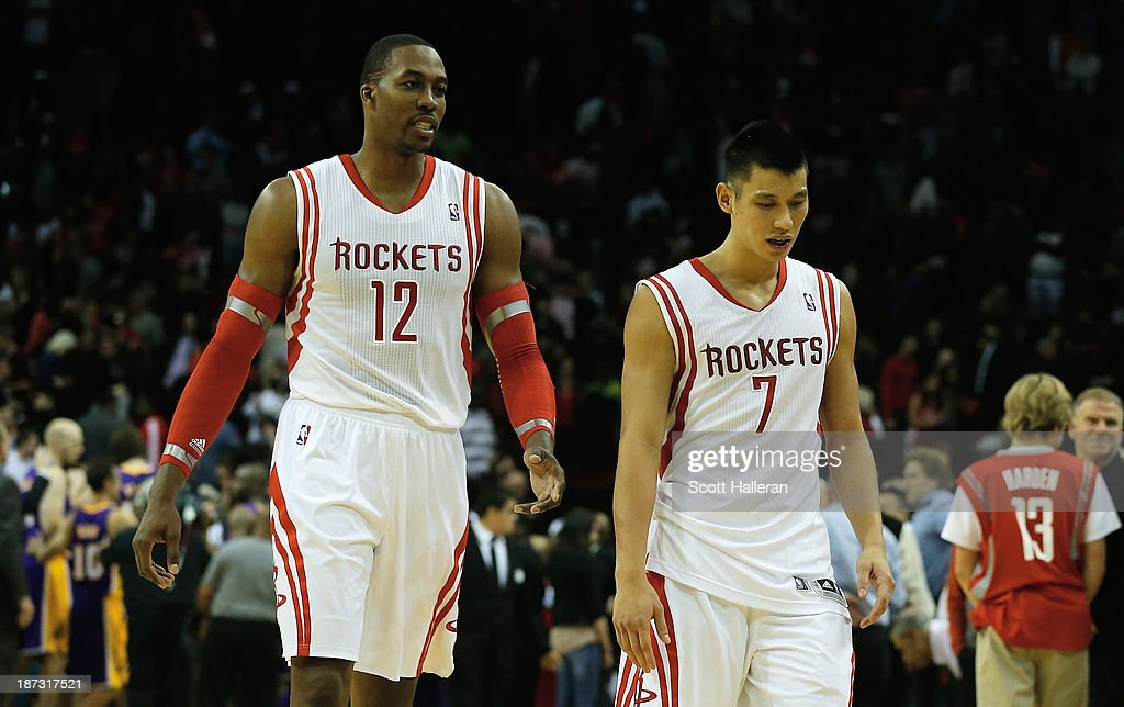 <a gi-track='captionPersonalityLinkClicked' href=/galleries/search?phrase=Dwight+Howard&family=editorial&specificpeople=201570 ng-click='$event.stopPropagation()'>Dwight Howard</a> #12 and <a gi-track='captionPersonalityLinkClicked' href=/galleries/search?phrase=Jeremy+Lin&family=editorial&specificpeople=6669516 ng-click='$event.stopPropagation()'>Jeremy Lin</a> #7 of the Houston Rockets walk off the court after losing to the Los Angeles Lakers 99-98 during the game at Toyota Center on November 7, 2013 in Houston, Texas.