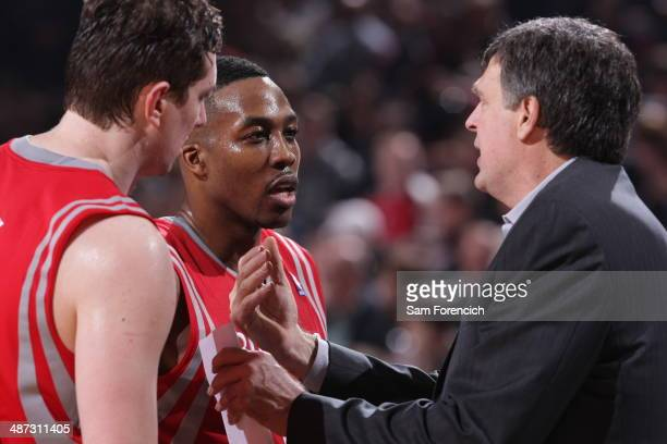 Dwight Howard and Kevin McHale of the Houston Rockets talk against the Portland Trail Blazers in Game Three of the Western Conference Quarterfinals...