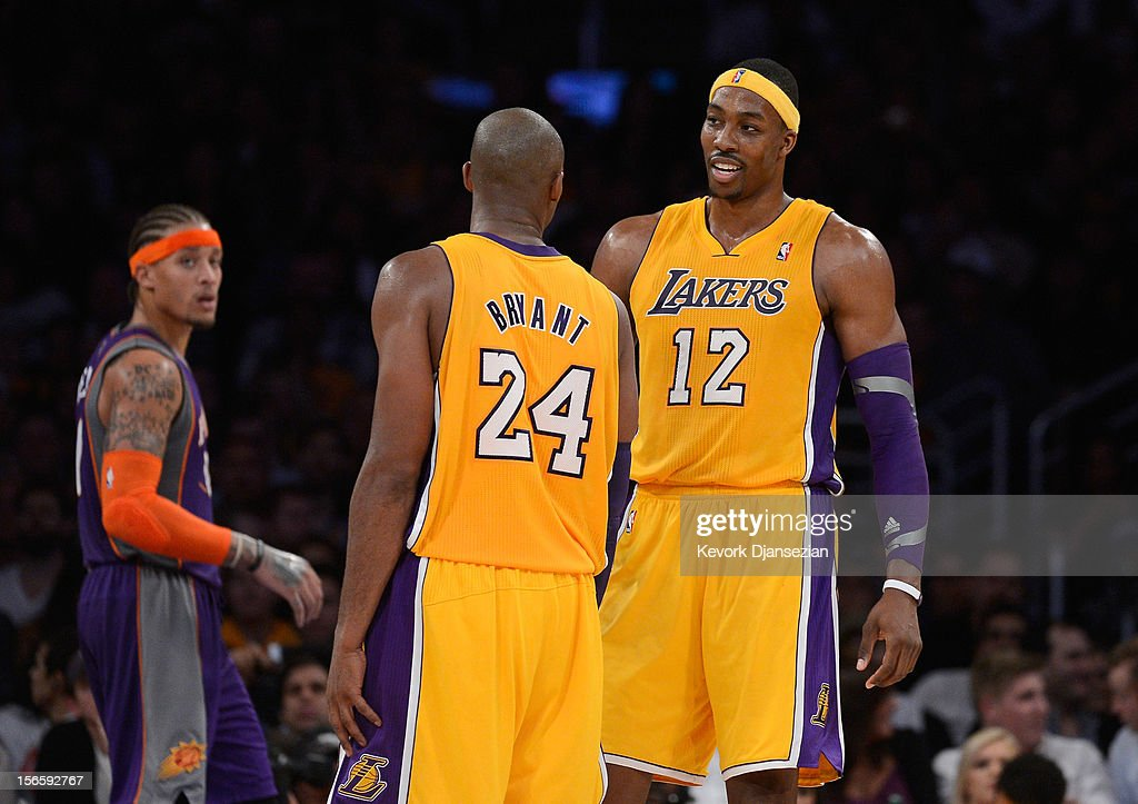 Dwight Howard #12 and Kobe Bryant #24 of the Los Angeles Lakers during the basketball game against Phoenix Suns at Staples Center on November 16, 2012 in Los Angeles, California.