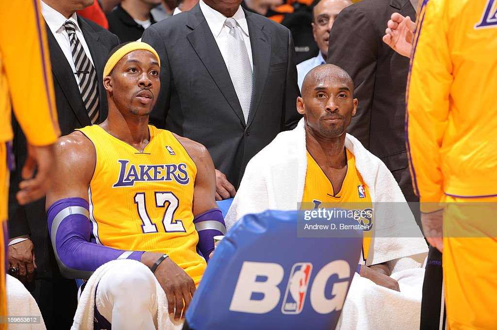 Dwight Howard #12 and Kobe Bryant #24 of the Los Angeles Lakers look on from the bench against the Miami Heat at Staples Center on January 15, 2013 in Los Angeles, California.