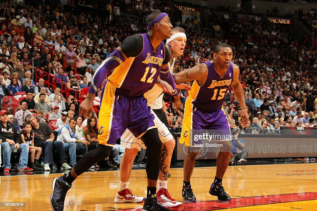 Dwight Howard #12 and Metta World Peace #15 of the Los Angeles Lakers guard Chris Andersen #11 of the Miami Heat as they wait for a rebound during a game between the Los Angeles Lakers and the Miami Heat on February 10, 2013 at American Airlines Arena in Miami, Florida.