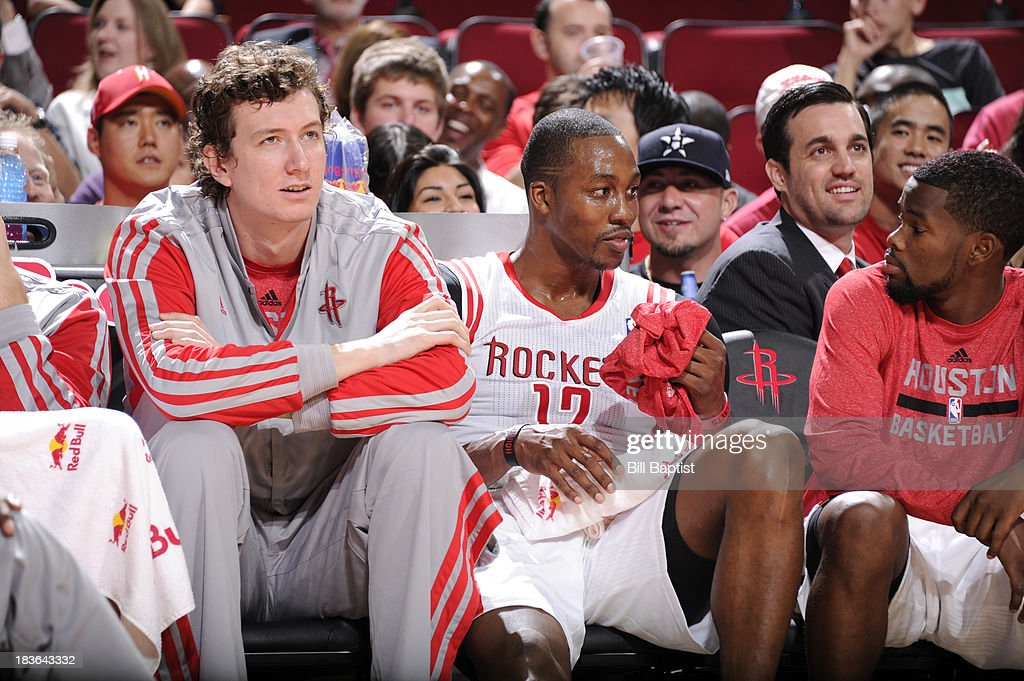 Dwight Howard #12 and Omer Asik #3 of the Houston Rockets react to a play against the New Orleans Pelicans during the 2013 NBA pre-season game on October 5, 2013 at the Toyota Center in Houston, Texas.