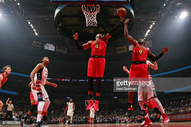 Dwight Howard and Paul Millsap of the Atlanta Hawks go for the rebound during the game against the Washington Wizards in Game Five of the Eastern...
