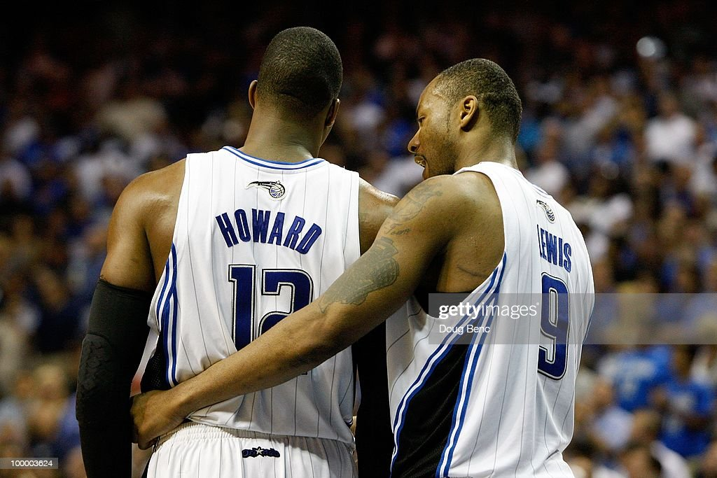 Dwight Howard #12 and Rashard Lewis #9 of the Orlando Magic talk against the Boston Celtics in Game Two of the Eastern Conference Finals during the 2010 NBA Playoffs at Amway Arena on May 18, 2010 in Orlando, Florida.