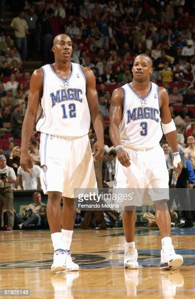 Dwight Howard and Steve Francis of the Orlando Magic walk on the court during the game against the San Antonio Spurs at TD Waterhouse Centre on...