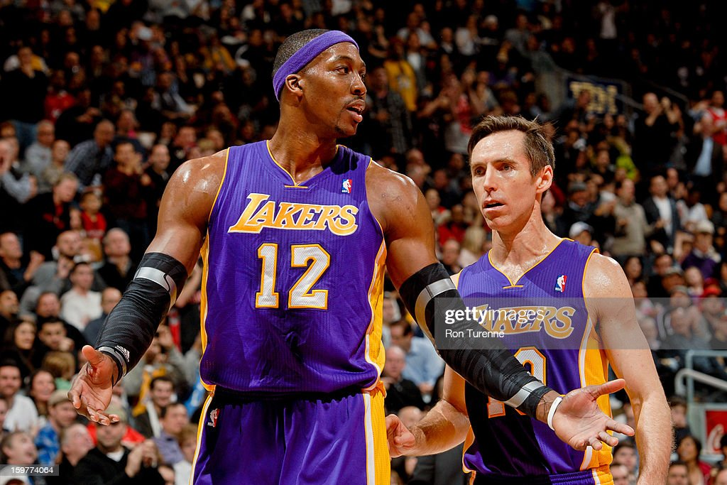Dwight Howard #12 and Steve Nash #10 of the Los Angeles Lakers speak during a game against the Toronto Raptors on January 20, 2013 at the Air Canada Centre in Toronto, Ontario, Canada.