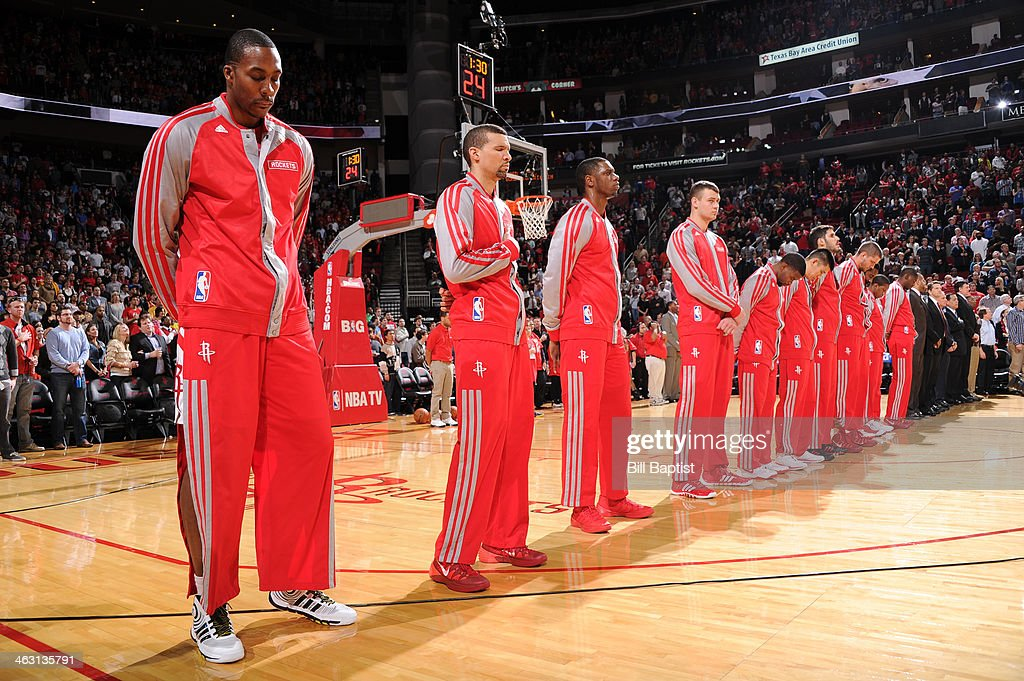 Dwight Howard #12 and the Houston Rockets stand during the National Anthem before the game against the Oklahoma City Thunder on January 16, 2014 at the Toyota Center in Houston, Texas.