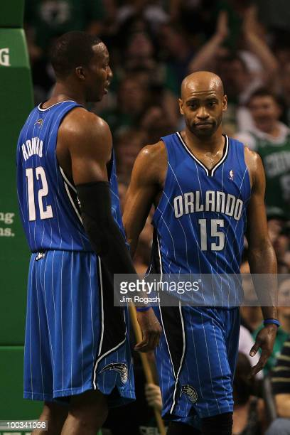 Dwight Howard and Vince Carter of the Orlando Magic talk on court against the Boston Celtics at TD Banknorth Garden in Game Three of the Eastern...