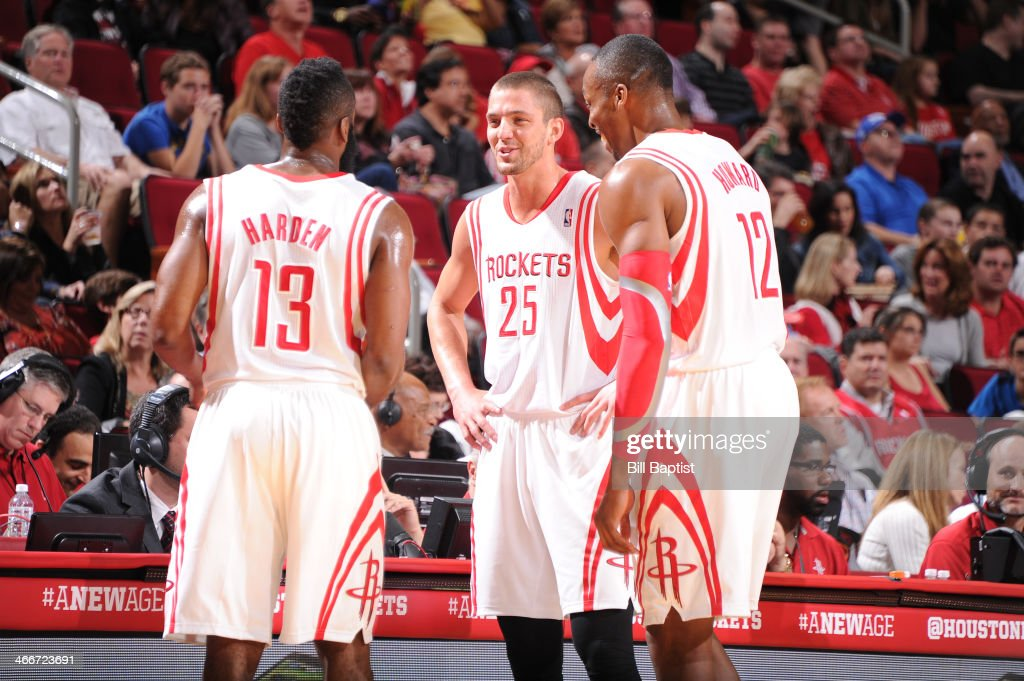 <a gi-track='captionPersonalityLinkClicked' href=/galleries/search?phrase=Dwight+Howard&family=editorial&specificpeople=201570 ng-click='$event.stopPropagation()'>Dwight Howard</a> #12, <a gi-track='captionPersonalityLinkClicked' href=/galleries/search?phrase=Chandler+Parsons&family=editorial&specificpeople=4249869 ng-click='$event.stopPropagation()'>Chandler Parsons</a> #25 and <a gi-track='captionPersonalityLinkClicked' href=/galleries/search?phrase=James+Harden&family=editorial&specificpeople=4215938 ng-click='$event.stopPropagation()'>James Harden</a> #13 of the Houston Rockets talk during the game against the Cleveland Cavaliers on February 1, 2014 at the Toyota Center in Houston, Texas.