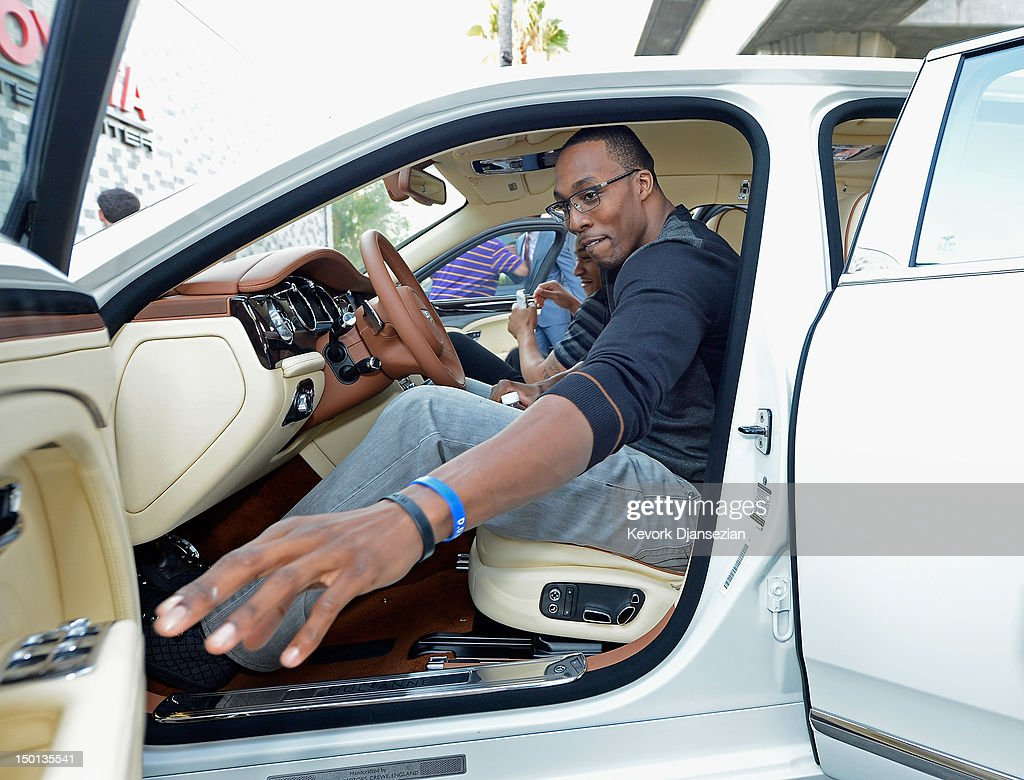 <a gi-track='captionPersonalityLinkClicked' href=/galleries/search?phrase=Dwight+Howard&family=editorial&specificpeople=201570 ng-click='$event.stopPropagation()'>Dwight Howard</a> gets behind the wheel of his Bentley after he was introduced to the media as the newest member of the Los Angeles Lakers at the Toyota Sports Center on August 10, 2012 in El Segundo, California. The Lakers acquired Howard from Orlando Magic in a four-team trade. In addition Lakers wil receive Chris Duhon and Earl Clark from the Magic.