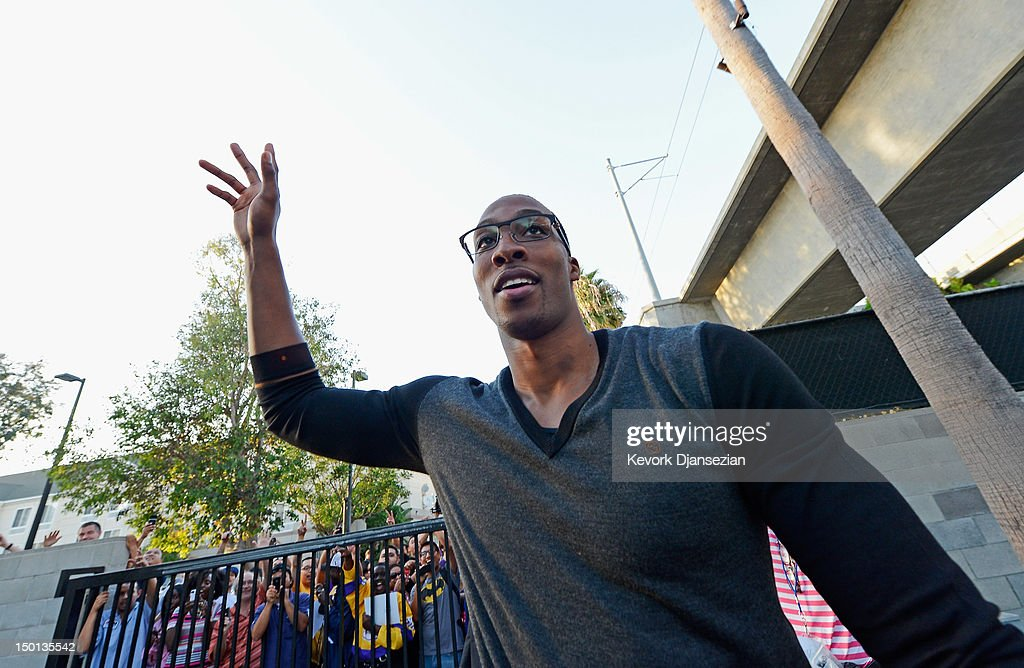 <a gi-track='captionPersonalityLinkClicked' href=/galleries/search?phrase=Dwight+Howard&family=editorial&specificpeople=201570 ng-click='$event.stopPropagation()'>Dwight Howard</a> greets fans after he was introduced as the newest member of the Los Angeles Lakers at the Toyota Sports Center on August 10, 2012 in El Segundo, California. The Lakers acquired Howard from Orlando Magic in a four-team trade. In addition Lakers wil receive Chris Duhon and Earl Clark from the Magic.