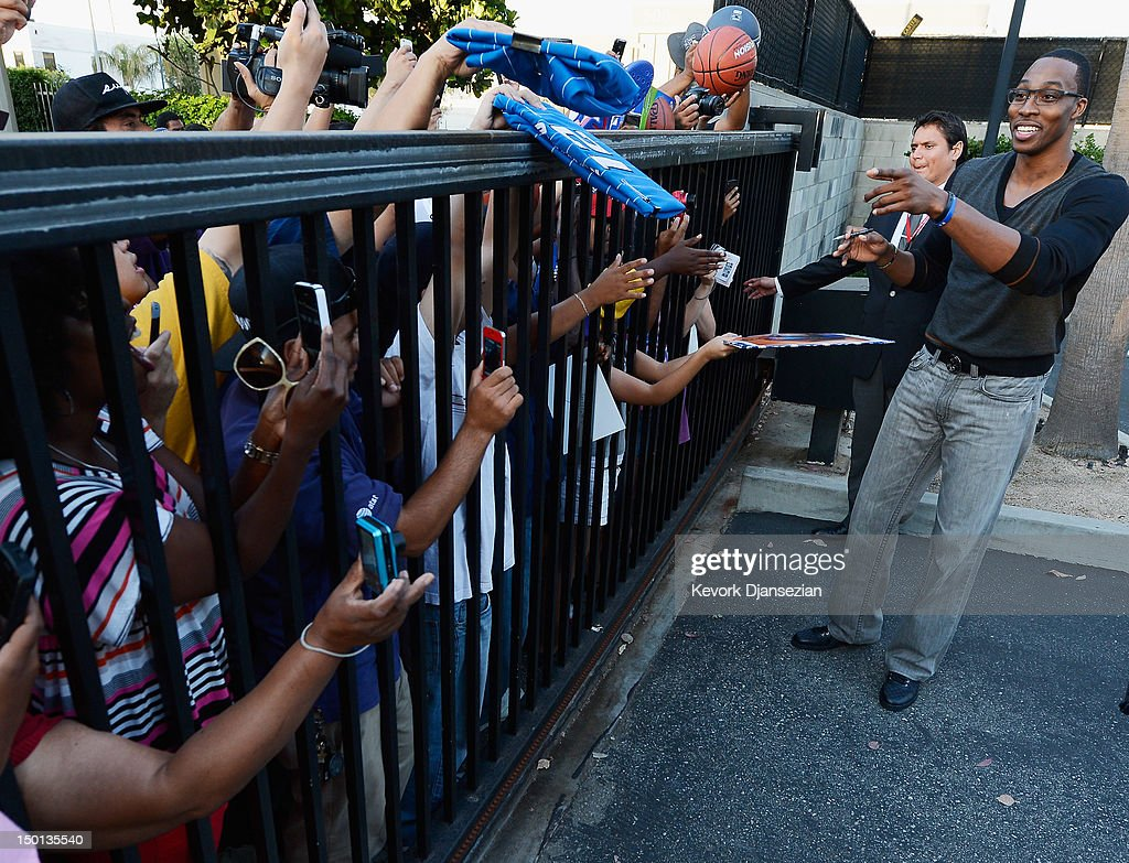 <a gi-track='captionPersonalityLinkClicked' href=/galleries/search?phrase=Dwight+Howard&family=editorial&specificpeople=201570 ng-click='$event.stopPropagation()'>Dwight Howard</a> greets fans after he was introduced to the media as the newest member of the Los Angeles Lakers at the Toyota Sports Center on August 10, 2012 in El Segundo, California. The Lakers acquired Howard from Orlando Magic in a four-team trade. In addition Lakers wil receive Chris Duhon and Earl Clark from the Magic.