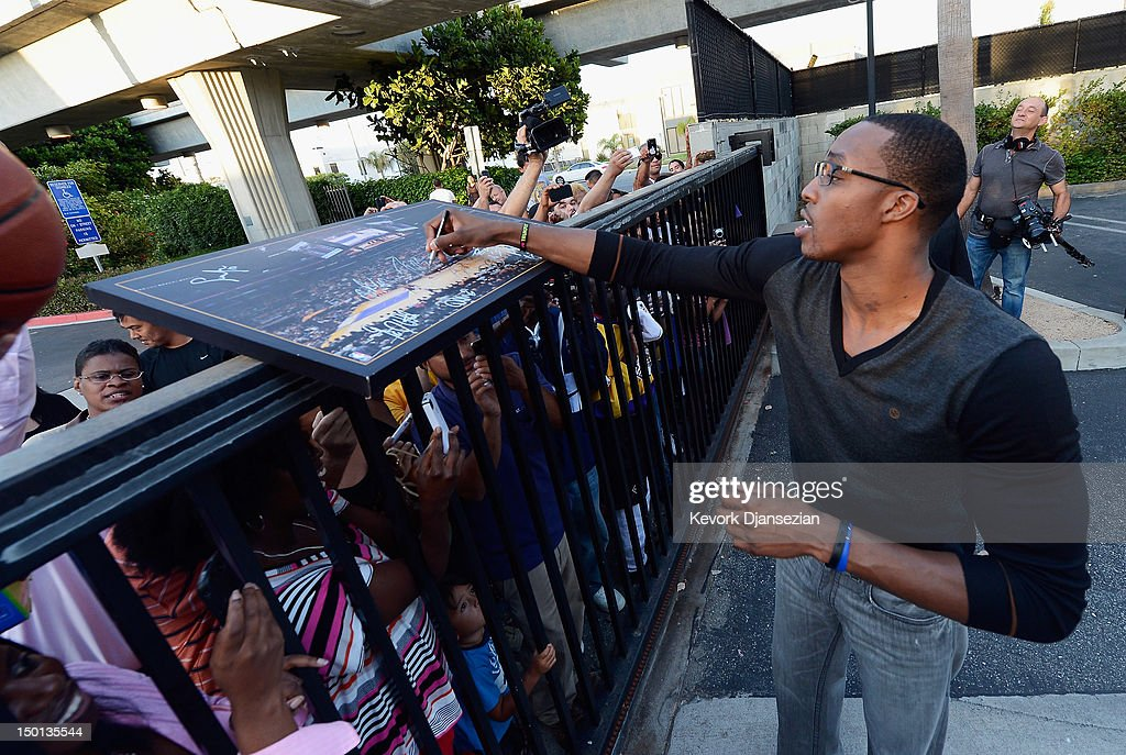 <a gi-track='captionPersonalityLinkClicked' href=/galleries/search?phrase=Dwight+Howard&family=editorial&specificpeople=201570 ng-click='$event.stopPropagation()'>Dwight Howard</a> greets fans after he was introduced to the media as the newest member of the Los Angeles Lakers at the Toyota Sports Center on August 10, 2012 in El Segundo, California. The Lakers aquired Howard from Orlando Magic in a four-team trade. In addition Lakers will receive Chris Duhon and Earl Clark from the Magic.