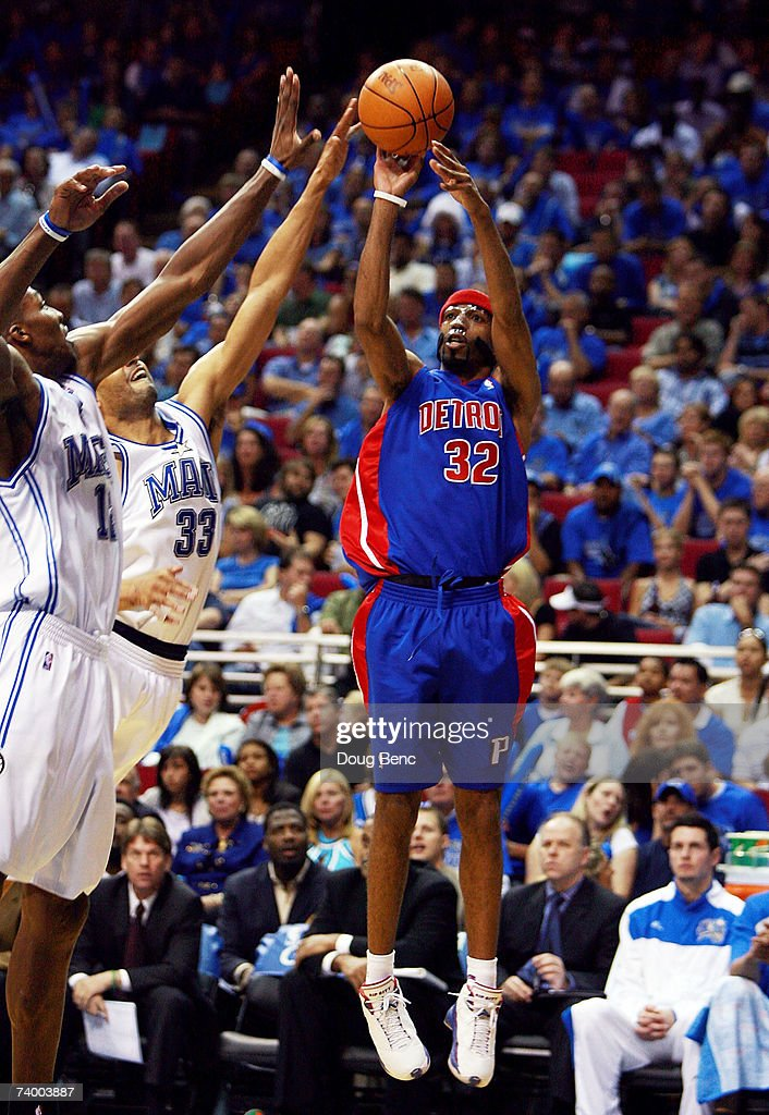 Dwight Howard #12 helps out as teammate Grant Hill #33 of the Orlando Magic blocks a shot attempt by Richard Hamilton #32 of the Detroit Pistons in Game 3 of the Eastern Conference Quarterfinals during the 2007 NBA Playoffs at Amway Arena on April 26, 2007 in Orlando, Florida. The Pistons defeated the Magic 93-77.