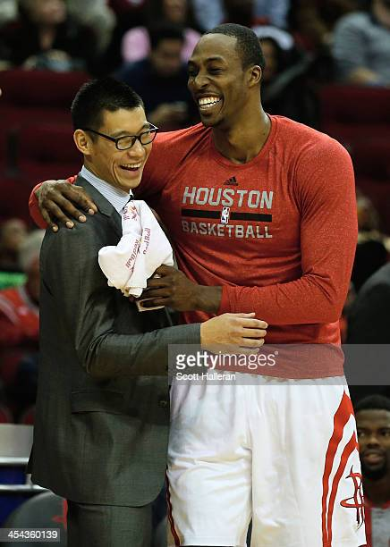 Dwight Howard hugs Jeremy Lin of the Houston Rockets during a timeout during the game against the Orlando Magic at Toyota Center on December 8 2013...