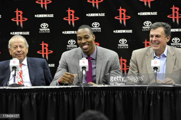 Dwight Howard is introduced as the newest Rocket by Rockets Owner Leslie Alexander and coach Kevin McHale Dwight Howard smiles while he speaks with...