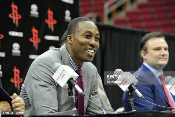 Dwight Howard is introduced as the newest Rocket by Rockets Owner Leslie Alexander Dwight Howard smiles while he speaks with the media on July 13...