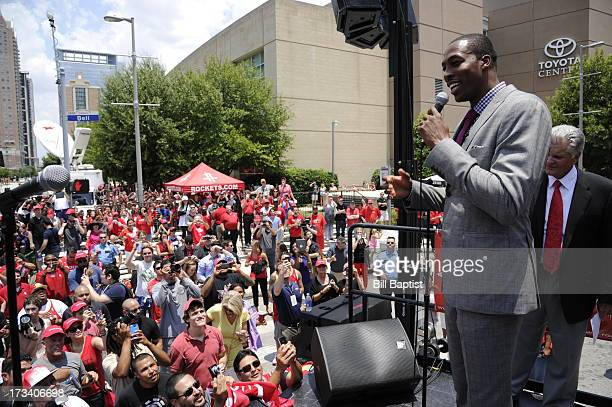 Dwight Howard is introduced as the newest Rocket by Rockets Owner Leslie Alexander Dwight also addresses fans outside of the Toyota Center on July 13...