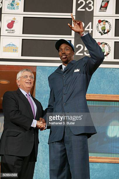 Dwight Howard is selected overall by the Orlando Magic as he shakes hands with Commissioner David Stern during the 2004 NBA Draft on June 24 2004 at...