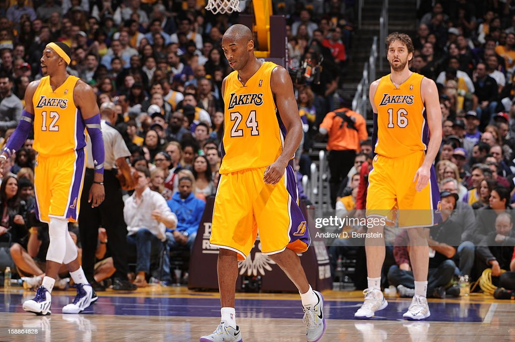 Dwight Howard #12, Kobe Bryant #23, and Pau Gasol #16 of the Los Angeles Lakers look on against the Philadelphia 76ers at Staples Center on January 1, 2013 in Los Angeles, California.