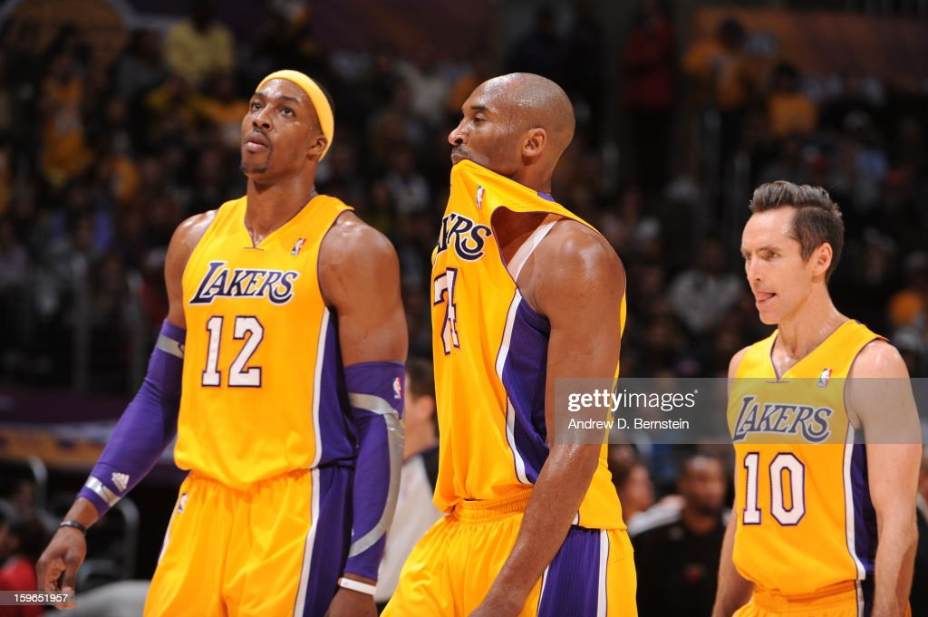 Dwight Howard #12, Kobe Bryant #24, and Steve Nash #10 of the Los Angeles Lakers walk toward the bench against the Miami Heat at Staples Center on January 15, 2013 in Los Angeles, California.