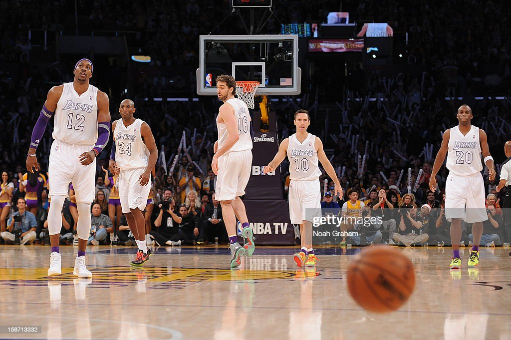 Dwight Howard #12, Kobe Bryant #24, Pau Gasol #16, Steve Nash, and Jodie Meeks #20 of the Los Angeles Lakers look on against the New York Knicks at Staples Center on December 25, 2012 in Los Angeles, California.