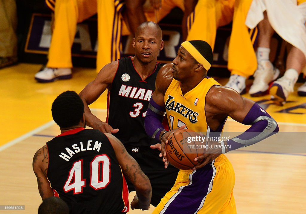 Dwight Howard (R) of Los Angeles Lakers tries to put a shot against Ray Allen (C) and Udonis Haslem Miami Heat during their NBA game on January 17, 2013 in Los Angeles, California. AFP PHOTO / Frederic J. BROWN