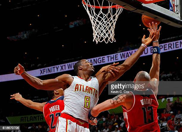 Dwight Howard of the Atlanta Hawks battles for a rebound against Otto Porter Jr #22 and Marcin Gortat of the Washington Wizards at Philips Arena on...