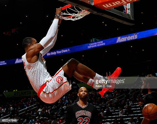 Dwight Howard of the Atlanta Hawks dunks againsty Taj Gibson and Robin Lopez of the Chicago Bulls at Philips Arena on January 20 2017 in Atlanta...