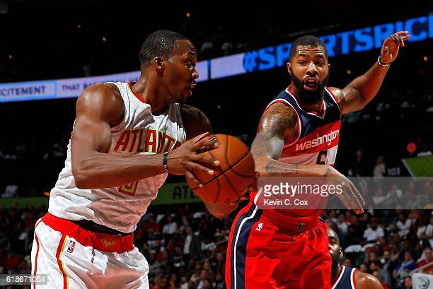 Dwight Howard of the Atlanta Hawks grabs a rebound against Markieff Morris of the Washington Wizards at Philips Arena on October 27 2016 in Atlanta...