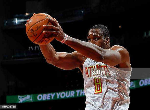 Dwight Howard of the Atlanta Hawks grabs a rebound against the New Orleans Pelicans at Philips Arena on October 18 2016 in Atlanta Georgia NOTE TO...