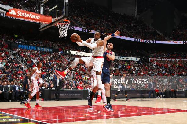 Dwight Howard of the Atlanta Hawks grabs the rebound against the Washington Wizards during Game Four of the Eastern Conference Quarterfinals of the...