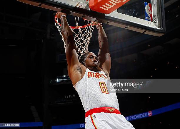 Dwight Howard of the Atlanta Hawks hangs from the basket prior to facing the Detroit Pistons at Philips Arena on October 13 2016 in Atlanta Georgia...
