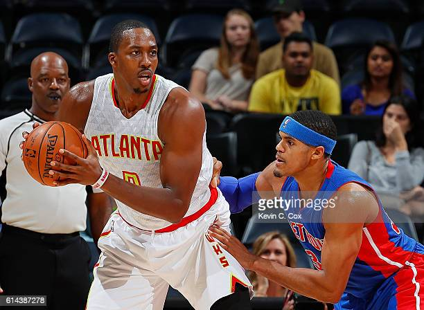Dwight Howard of the Atlanta Hawks looks to drive against Tobias Harris of the Detroit Pistons at Philips Arena on October 13 2016 in Atlanta Georgia...