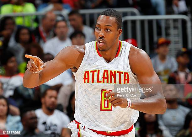 Dwight Howard of the Atlanta Hawks reacts after scoring a basket against the Cleveland Cavaliers at Philips Arena on October 10 2016 in Atlanta...