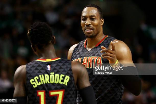 Dwight Howard of the Atlanta Hawks talks with Dennis Schroder during the second quarter against the Boston Celtics at TD Garden on February 27 2017...