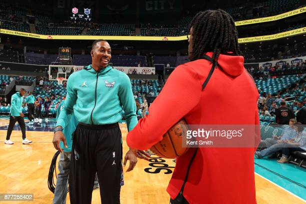Dwight Howard of the Charlotte Hornets and Taurean Prince of the Atlanta Hawks talk before the game on October 20 2017 at Spectrum Center in...