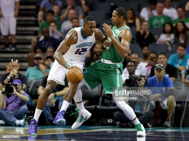 Dwight Howard of the Charlotte Hornets drives to the basket against Al Horford of the Boston Celtics during their game at Spectrum Center on October...