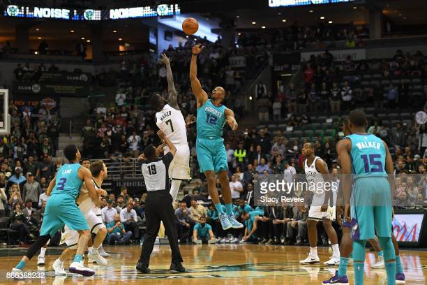 Dwight Howard of the Charlotte Hornets jumps with Thon Maker of the Milwaukee Bucks to start a game at the BMO Harris Bradley Center on October 23...