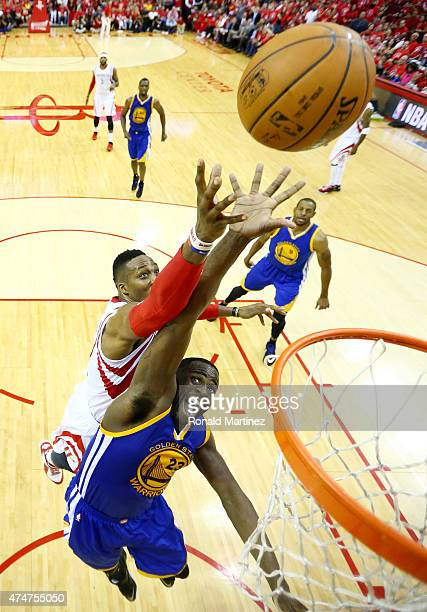 Dwight Howard of the Houston Rockets and Draymond Green of the Golden State Warriors vie for a rebound in the second half during Game Four of the...