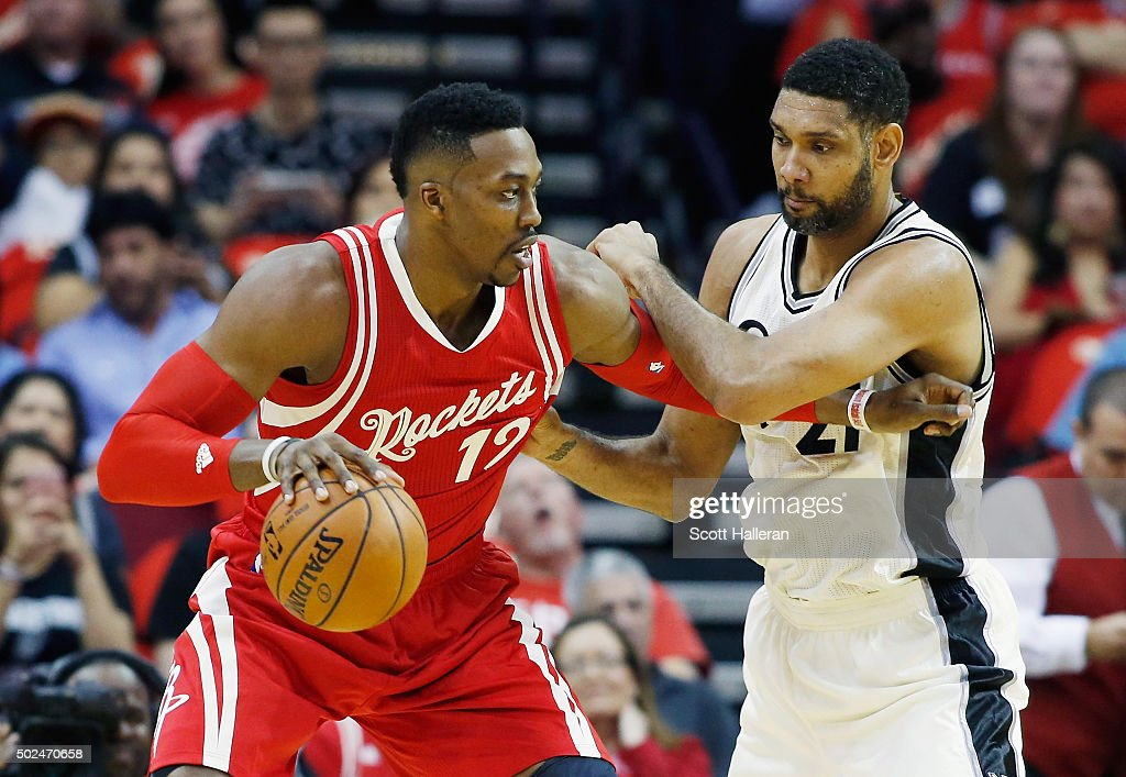 <a gi-track='captionPersonalityLinkClicked' href=/galleries/search?phrase=Dwight+Howard&family=editorial&specificpeople=201570 ng-click='$event.stopPropagation()'>Dwight Howard</a> #12 of the Houston Rockets and <a gi-track='captionPersonalityLinkClicked' href=/galleries/search?phrase=Tim+Duncan&family=editorial&specificpeople=201467 ng-click='$event.stopPropagation()'>Tim Duncan</a> #21 of the San Antonio Spurs battle for the position during their game at the Toyota Center on December 25, 2015 in Houston, Texas.
