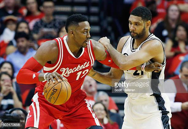 Dwight Howard of the Houston Rockets and Tim Duncan of the San Antonio Spurs battle for the position during their game at the Toyota Center on...