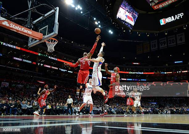 Dwight Howard of the Houston Rockets attempts to block a layup by Austin Rivers of the Los Angeles Clippers during the second half of the basketball...