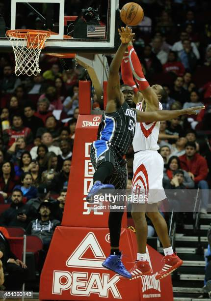 Dwight Howard of the Houston Rockets battles for a rebound with Jason Maxiell of the Orlando Magic at Toyota Center on December 8 2013 in Houston...